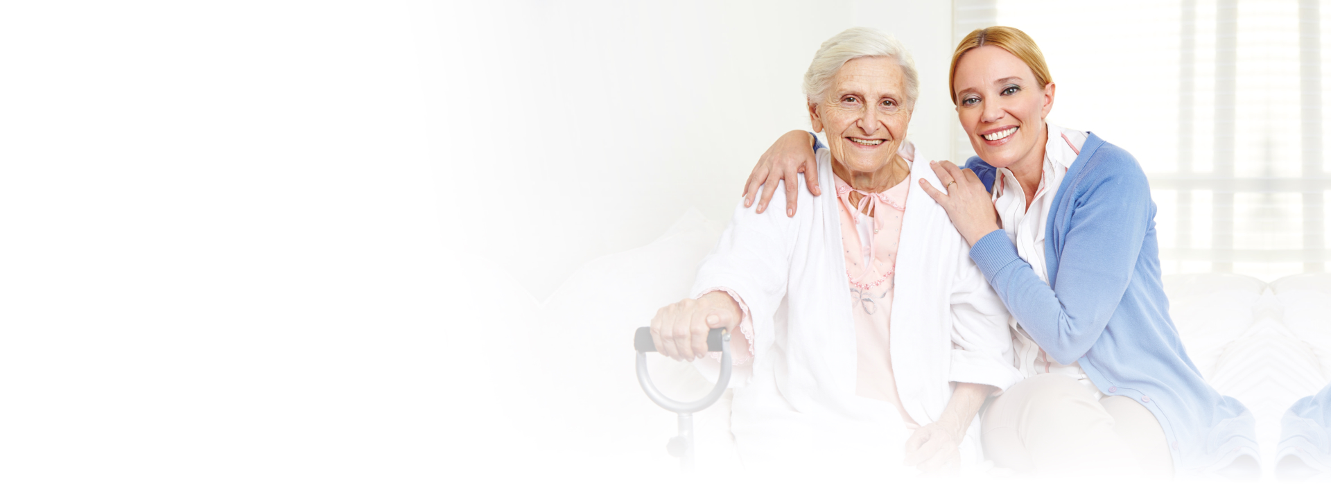 elderly womand and a womans smiling